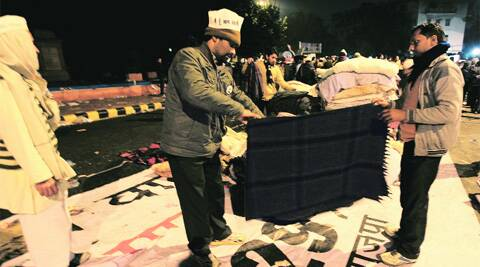 AAP workers fold blankets on Tuesday evening after their overnight agitation near Rail Bhawan was called off. (Ravi Kanojia)