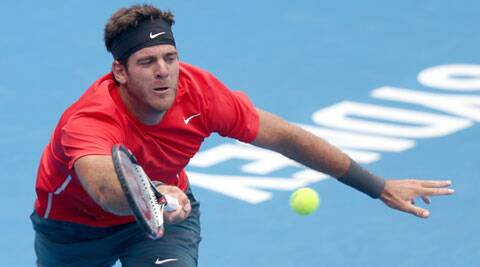 Juan Martin Del Potro of Argentina plays a shot to Dmitry Tursunov of Russia during their men's singles semifinal match at the Sydney International (AP)