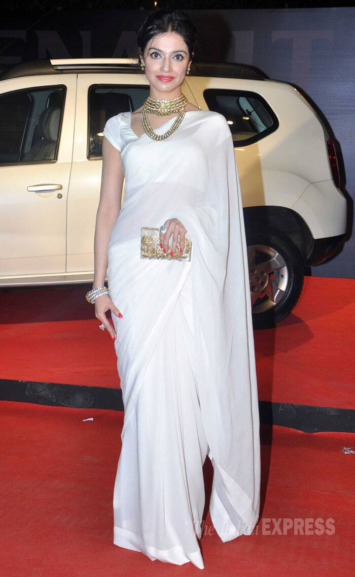 Debutante director Divya Khosla Kumar was pretty in a white Nachiket Barve sari. She tied her hair in a neat updo and added a pop of red with her lip colour. We like! (Photo: Varinder Chawla)