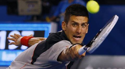 Novak Djokovic of Serbia hits a return to Denis Istomin of Uzbekistan during their men's singles match at the Australian Open 2014 (Reuters)