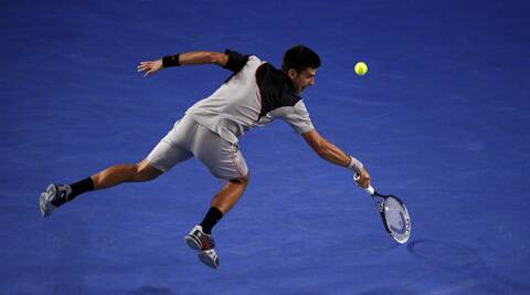 Novak Djokovic of Serbia hits a return to Stanislas Wawrinka of Switzerland during their men's singles quarter-final tennis match at the Australian Open 2014 (Reuters)