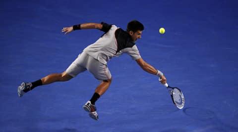 Novak Djokovic of Serbia hits a return to Stanislas Wawrinka of Switzerland during their men's singles quarter-final tennis match at the Australian Open 2014 (Reuters)