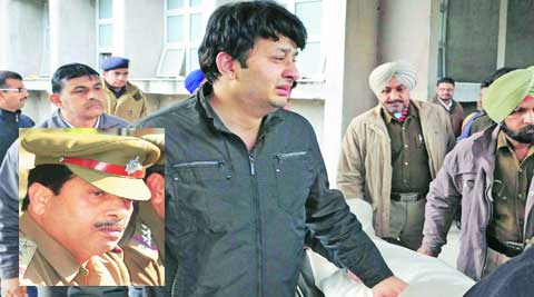 The DSP's son with the body outside PGI on Wednesday. (Express)