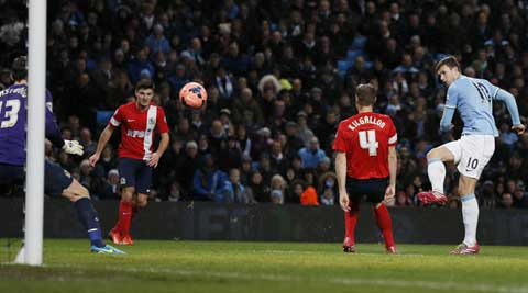 Manchester City's Edin Dzeko (R) shoots to score during their FA Cup third round soccer match against Blackburn Rovers at the Etihad stadium in Manchester (Reuters)