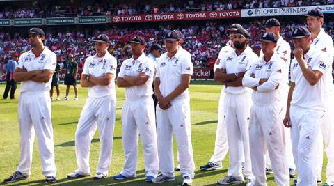 England's captain Alastair Cook (L) reacts next to his teammates during the presentation after they lost the fifth Ashes Test against Australia (Reuters)