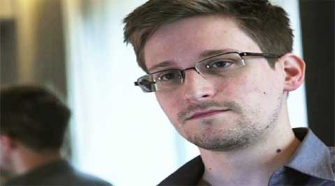 Attorney General Eric H Holder Jr Thursday said the United States was willing to discuss how the criminal case against Edward J Snowden would be handled, but only if Snowden pleaded guilty first.