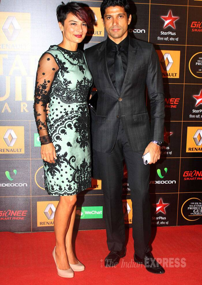 Farhan Akhtar walked the red carpet with wife Adhuna, who was chic in a sea blue and black lace short dress. (Photo: Varinder Chawla)