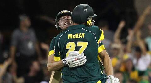 Australia's James Faulkner, left, and Clint McKay celebrate after winning the second One Day International cricket match against England at the Gabba (AP)