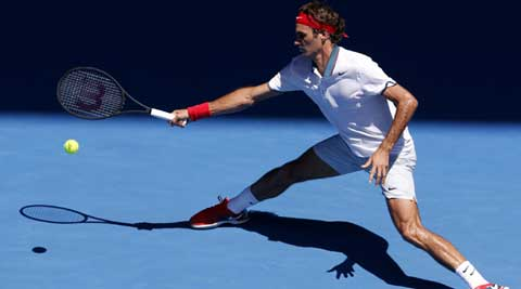 Roger Federer of Switzerland makes a forehand return to James Duckworth of Australia during their first round match at the Australian Open (AP)