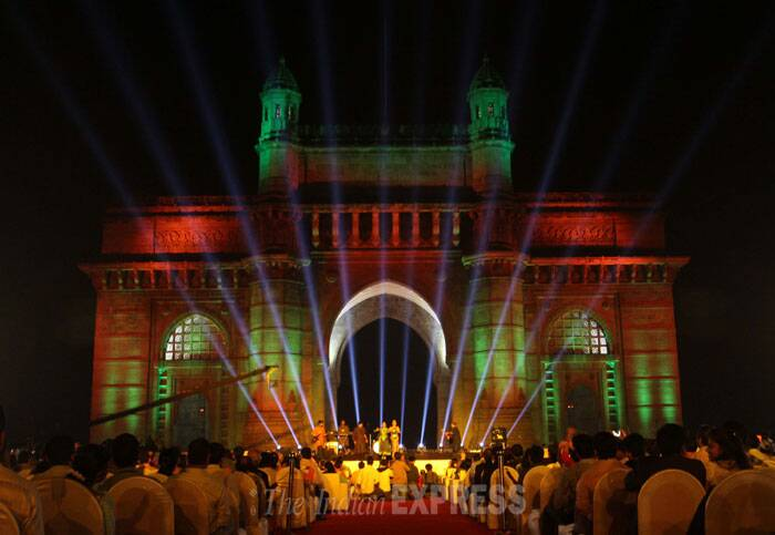 A dance group performs as spectators gather to watch a light show at the Gateway of India in Mumbai. (IE Photo: Dilip Kagda)