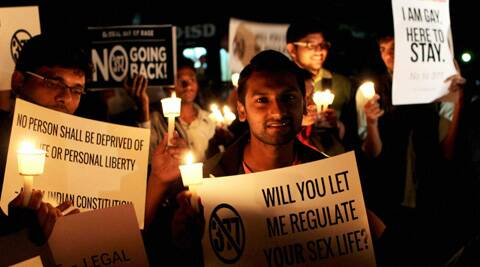 Members and supporters of LGBT Community hold pla cards and candles during a candle light vigil against the Supreme court, which refused to review verdict on gay sex, in Bengaluru on Tuesday. (PTI)