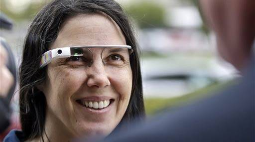Cecilia Abadie wears her Google Glass as she talks with her attorney outside of traffic court