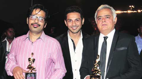 Sameer Gautam Singh, Apurva M. Asrani and Hansal Mehta pose with their Screen award for Best Screenplay