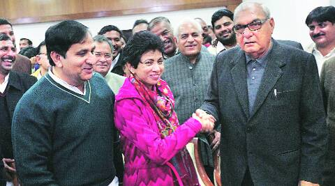 Selja with Bhupinder Singh Hooda after filing papers in Chandigarh, Tuesday.