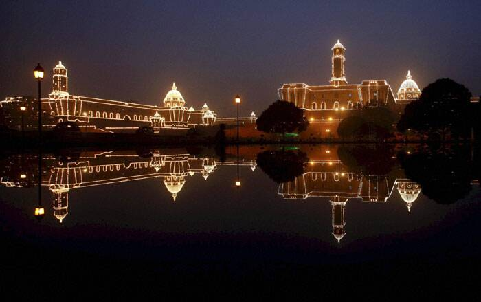 Illuminated Raisina Hill is reflected through the water of a fountain during the rehearsal for the Beating Retreat ceremony in New Delhi. (PTI)
