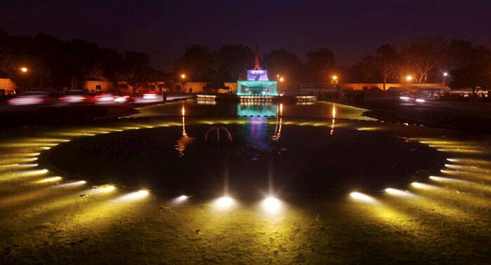 A decorated fountain near the illuminated Raisina Hill during the rehearsal for the Beating Retreat ceremony in New Delhi. (PTI)