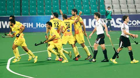 Indian players celebrate after scoring against Germany in their group-stage game on Monday. India drew 3-3 with Germany (IE Photo Ravi Kanojia)