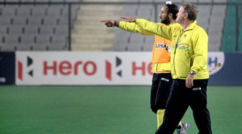 India coach Terry Walsh and captain Sardar Singh gesture during a training session on Thursday. India, ranked 10th in the world, are playing the World League Finals by virtue of being the hosts (IE Photo: Ravi Kanojia)
