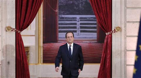 French President Francois Hollande arrives to deliver his speech at his annual news conference at the Elysee Palace in Paris. (AP)     French President Francois Hollande arrives to deliver his speech at his annual news conference at the Elysee Palace in Paris. (AP)