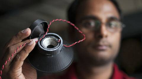 Graduate student Apoorva Kiran holds a 3-D printed, fully functional loudspeaker. (Cornell University)