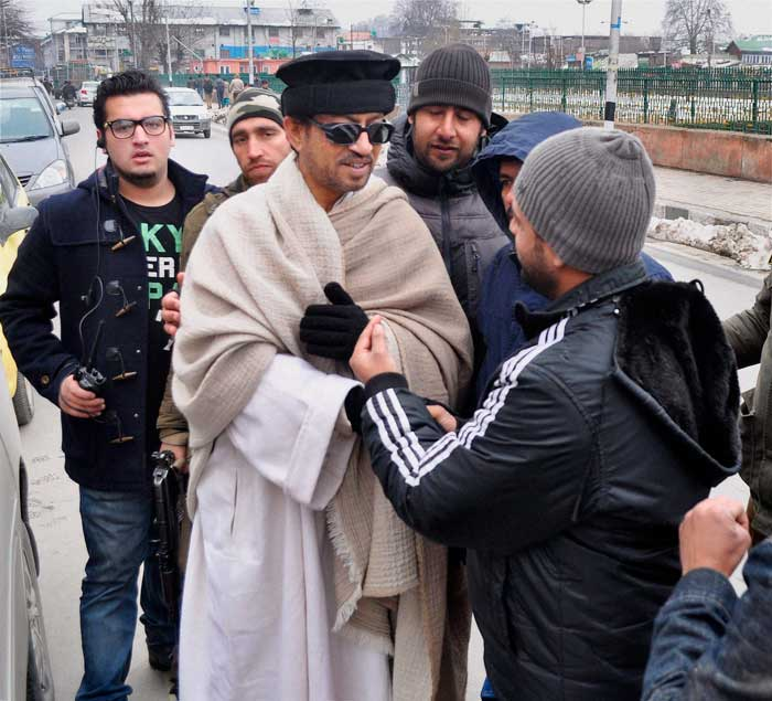 Bollywood actor Irrfan Khan is busy with the filming of his upcoming film 'Haider' and is currently in Kashmir shooting for the same. The film also stars actress Shraddha Kapoor, who is also in the state for the shoot. <br /><br /> Seen here, Irrfan braves the chill as he wraps himself in a shawl and gloves. (PTI)