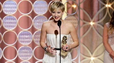 """Jennifer Lawrence, left, accepting the award for best supporting actress in a motion picture for her role in """"American Hustle,"""" during the 71st annual Golden Globe Awards. (AP)"""