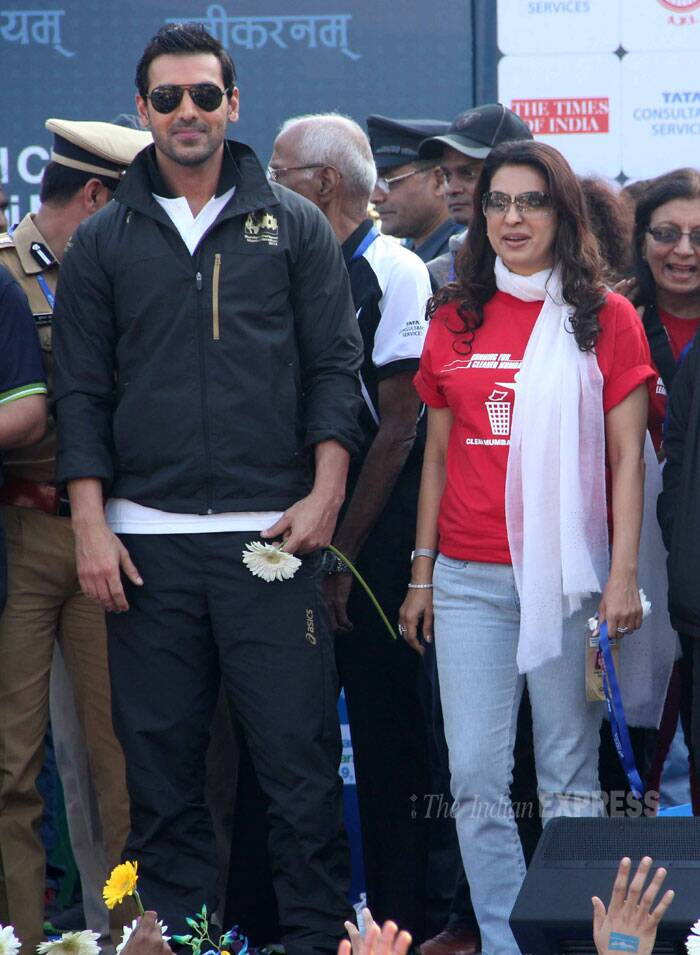 'Madras Cafe' actor John Abraham and Juhi Chawla pose for photogs at the Mumbai Marathon organised by a banking company in Mumbai on Sunday. (Photo: Varinder Chawla)