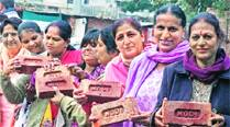 Women with the 'Modi bricks' in Chandigarh on Tuesday.