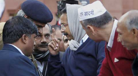 Delhi Chief Minister Arvind Kejriwal with his cabinet colleague Manish Sisodia near Rail Bhavan. (PTI)