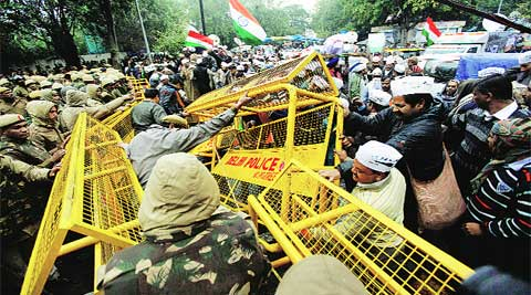 Policemen and AAP supporters clash near Rail Bhawan on Tuesday.