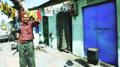 Nazir Khan Pathan outside his house in Naroda Patiya. (IE Photo: Javed raja)