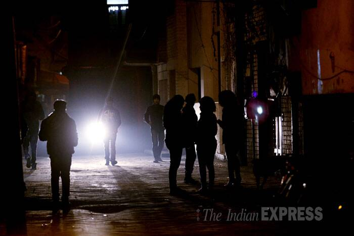 "Since that night, the area has been crawling with police, with barricades up and a PCR vehicle parked 24/7. Media crews keep trickling in, and in the evenings, television talk shows are held in neighbourhood parks, now labelled ""ground zero"". (IE Photo: Praveen Khanna)<br /><a href=""http://indianexpress.com/article/india/india-others/khirki-and-walls/0/"" target=""_blank""><font color=""#0260a8"">Read full story here.</font></a>"