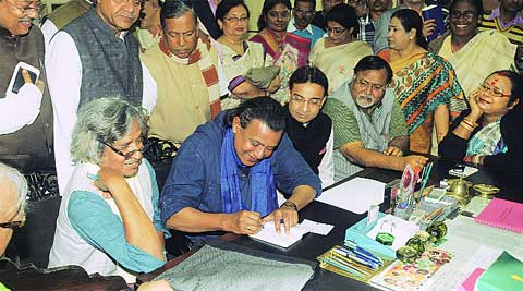 Mithun Chakraborty with K D Singh and Jogen Choudhury after filing nominations for Rajya Sabha, in Kolkata, on Monday. Partha Paul