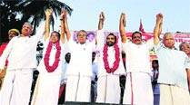 Pinarayi Vijayan flanked by O K Vasu (left) and A Ashokan, BJP rebels-turned-comrades.	S K Mohan