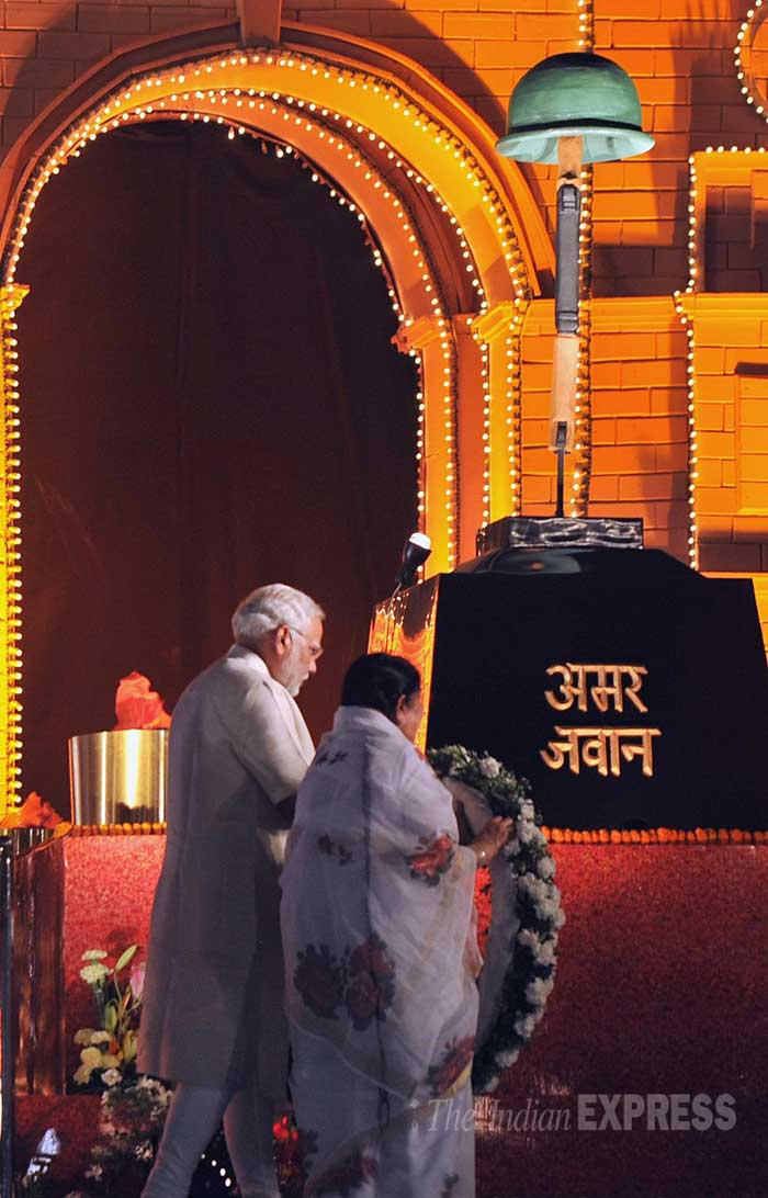 Lata Mangeshkar and Narendra Modi together carry a wreath at the memorial during felicitation. (IE Photo: Pradeep Kocharekar)