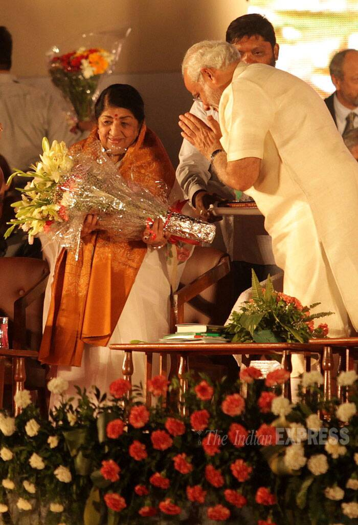 India's nightingale Lata Mangeshkar was felicitated by BJP's prime ministerial candidate Narendra Modi at a special event held at Mahalaxmi Racecourse in Mumbai on Monday (January 27) celebrating the 51st anniversary of her famous song, 'Ae mere watan ke logon'. (IE Photo: Ganesh Shirsekar)