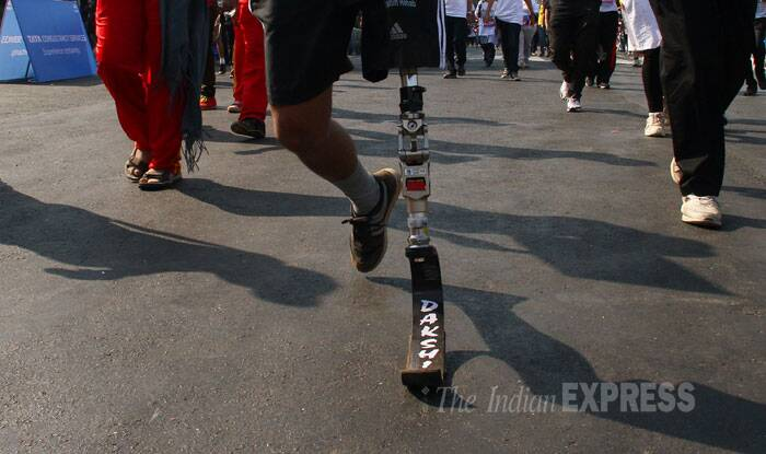 A man in  the marathon with an artificial leg. (IE Photo: Amit Chakravarty).