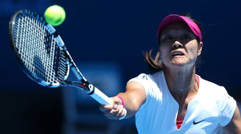 Li Na of China makes a forehand return to Ana Konjuh of Croatia during their first round match at the Australian Open tennis championship in Melbourne, Australia, Monday, Jan. 13, 2014.(AP Photo)