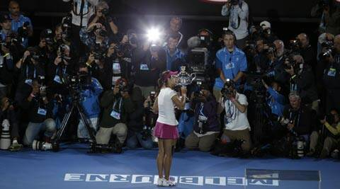 Li Na of China holds the championship trophy after defeating Dominika Cibulkova of Slovakia in their women's singles final at the Australian Open (AP)