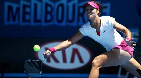 Li Na of China makes a forehand return to Eugenie Bouchard of Canada during their semifinal at the Australian Open (AP)
