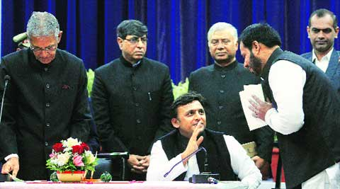 Minister Manoj Pandey, who was elevated to the Cabinet rank, with Chief Minister Akhilesh Yadav and Governor B L Joshi, at Raj Bhawan in Lucknow on Saturday.  Vishal Srivastav