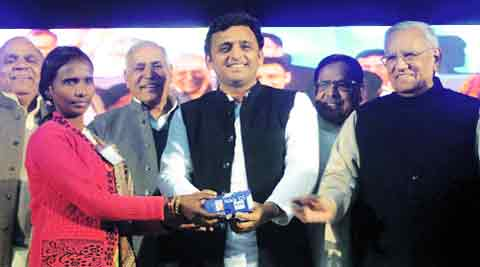 Chief Minister Akhilesh Yadav hands over a cellphone to a health worker after launching a scheme at Indira Gandhi Pratishthan, in Lucknow Sunday.Pramod Singh