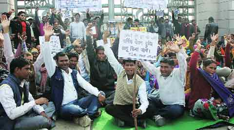 Memorial workers stage a dharna in front of B R Ambedkar Park, in Lucknow Sunday. Pramod Singh