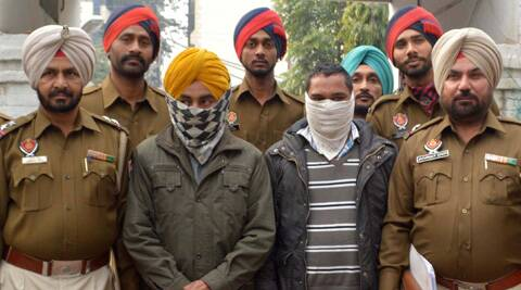 Police with the two arrested in the case of  heroin smuggling in Ludhiana.