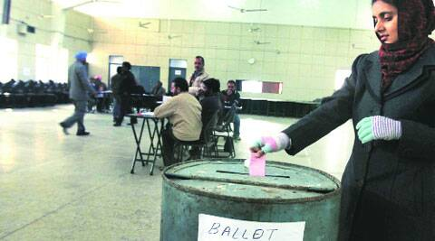 An employee casts her vote at  PAU  campus on Friday.  (IE Photo: Gurmeet Singh)