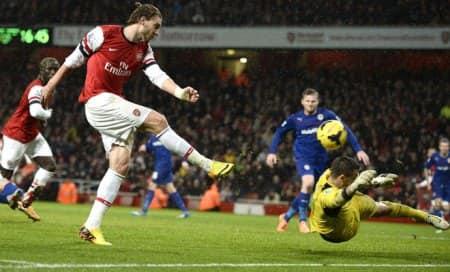 New dawn: Nicklas Bendtner goal keeps Gunners ontop