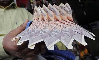 Indian rupee falls 36 paise to 62.26 against US dollar,hits one-month low