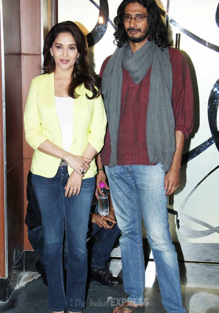 Bollywood's dance diva Madhuri Dixit, who has returned to the silver screen after a hiatus of 6 years with Abhishek Chaubey's 'Dedh Ishqiya' was spotted promoting the film with the director. (Photo: Varinder Chawla)