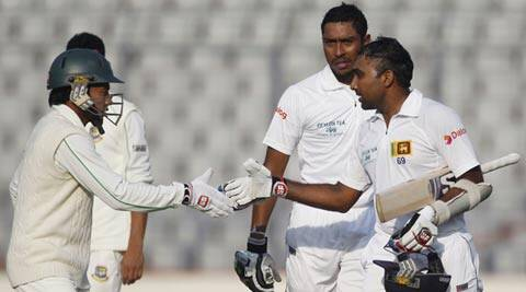 Bangladesh's captain Mushfiqur Rahim (L) congratulates Sri Lanka's Mahela Jayawardene (R) after he scored a double century during the third day of their first Test (Reuters)
