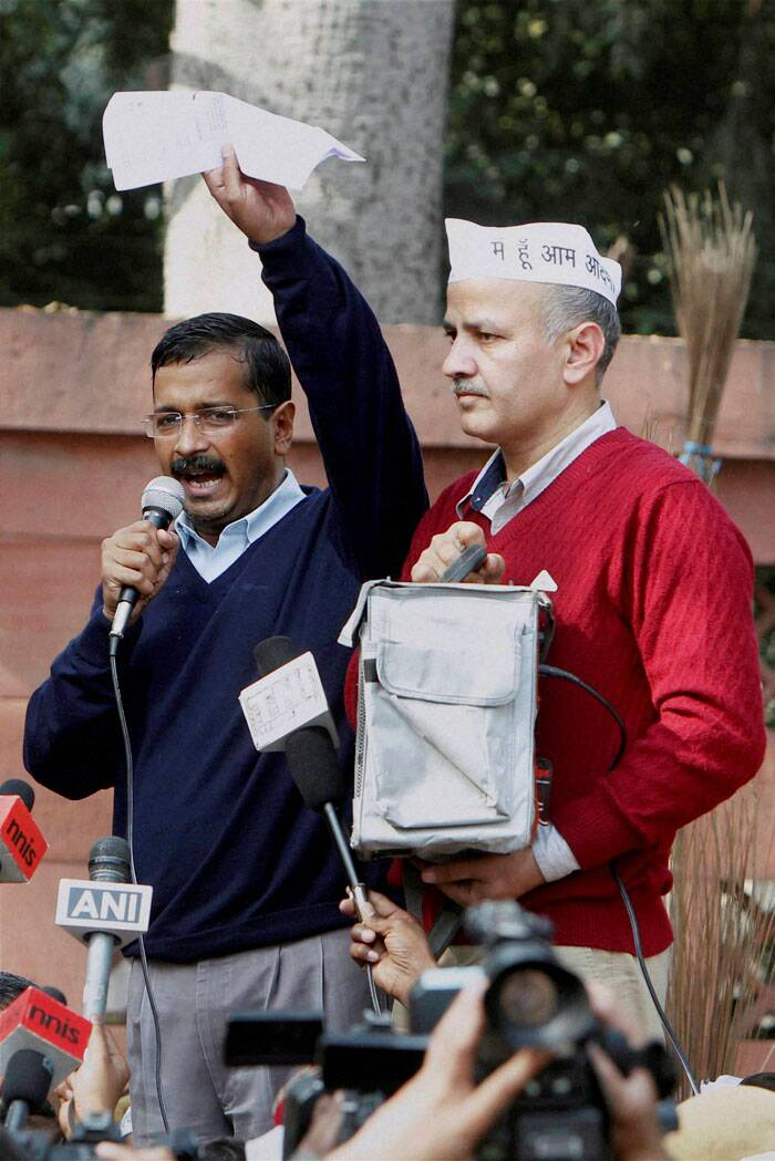 However, the police refused saying they have no warrant to do so. The AAP workers allegedly forced a couple of women from Uganda to give urine samples. Their action came under attack but the AAP government insists that action should be taken against the police officials. <br /> Delhi Education Minister Manish Sisodia stands next to CM Arvind Kejriwal in New Delhi. (IE Photo: Ravi Kanojia)